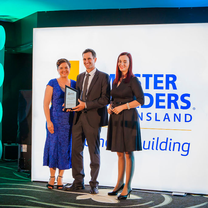 Dan and Liz accepting award from Master Builders Queensland