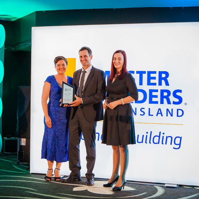Dan and Liz accepting award from Master Builders Queensland
